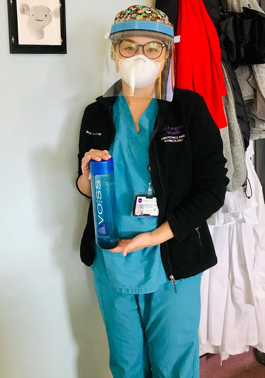 Hospital Nurse Holding Bottle of VOSS Water